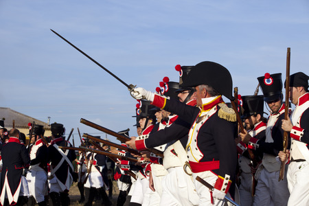 marshal: BADAJOZ SPAIN  MAY 9: Reenactment of Albuera battle between French and allied nations armies in 1811. May 9 2015 in La Albuera Spain. Battalion guided by one marshal Editorial