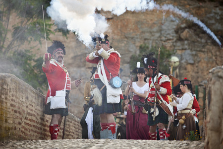 allied: BADAJOZ SPAIN  MAY 9: Reenactment of Albuera battle between French and allied nations armies in 1811. May 9 2015 in La Albuera Badajoz Spain. Scottish troops defending the bridge Editorial