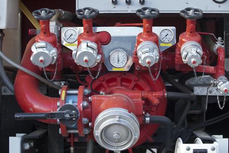 PUMPER: Fire pump panel on fire truck. Discharge gauges and piston valve