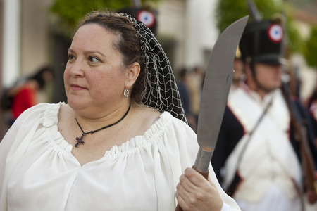 allied: BADAJOZ SPAIN  MAY 9: Reenactment of Albuera battle between French and allied nations armies in 1811. May 9 2015 in La Albuera Badajoz Spain. Warrior woman with knife Editorial