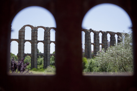 memorial plaque: View of Roman Aqueduct Los Milagros from the memorial plaque with arches shape . Extremadura, Spain