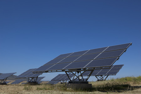 nonpolluting: Solar photovoltaics panels field for renewable energy production with blue sky, Spain