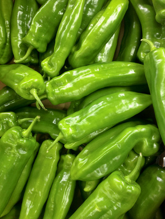 mild: Box of green italian peppers on supermarket