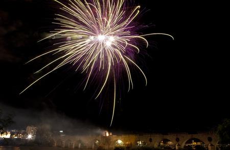 Colorful fireworks shot from Puente de Palmas bridge at Badajoz, Spain, during the San Juan festivity night