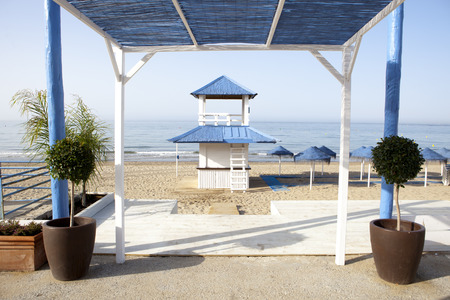 refreshments: Wooden blue and white beach refreshments stand and pergola at beautiful white beach of south Spain Stock Photo