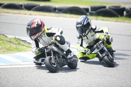 mini bike: MARBELLA - JUL 5: kids riding at one min-ibike junior competition on training at Funny Beach circuit on Jule 5, 2015 in Marbella, Spain Editorial