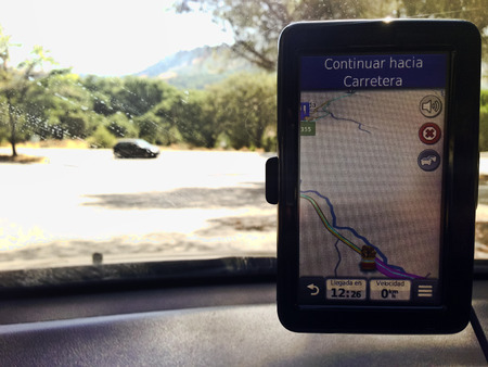 satelite: Driving with satelite navigationGPS device by rural area roads, Spain