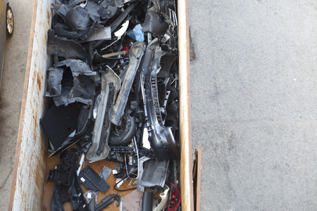 corroding: Container full of pieces of cars at car workshop