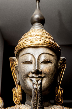 worshipper: Buddha images, Closeup sculpture of Thai Wooden praying buddha Stock Photo