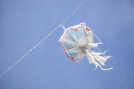 plastic made: Hanging jellyfish made of recycled plastic over blue sky
