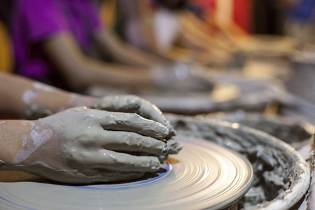 potters wheel: Children learning to work  with potters wheel