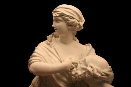 escultura romana: Roman Charity sculpture isolated over black background