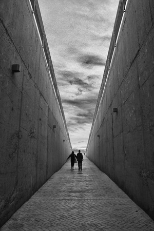 people shadow: A couple came out by the exit tunnel. Light in the end of the tunnel