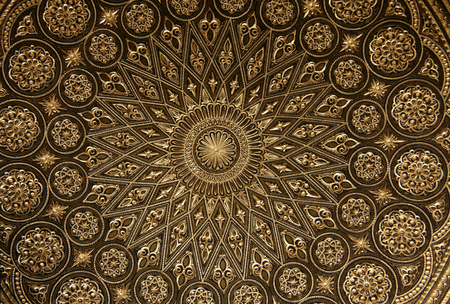 gold metal background: Detail of damascening plate. Traditional handicraft with metal in Toledo, Spain