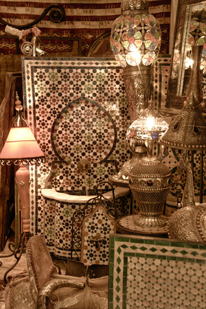 gold souk: Background from shining arabic lamps and glazed tile fountains shop. Toledo, Spain