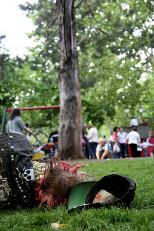 punk hair: SPAIN, CACERES - 12 MAY: Young punk rocker sleeping in the park during the World Music Festival Womad, Caceres, 12 may, 2017 Editorial