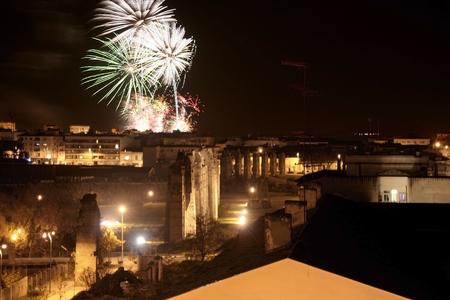 merida: Colorful fireworks shot with aqueduct of Milagros at Merida, Spain