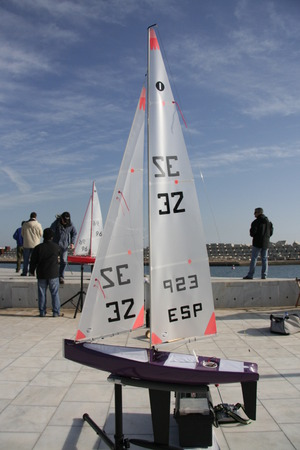 remote controlled: BARCELONA, SPAIN - DEC 29, 2007: People racing remote controlled sailing wooden yachts at Forum Port