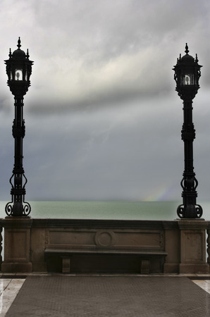 two visions: Stormy weather on the sea between two lanterns, Cadiz, Spain