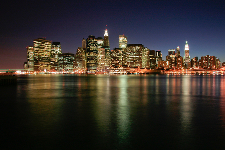 manhattan mirror new york: Image of New York City Skyline as viewed from Brooklyn at dusk Stock Photo