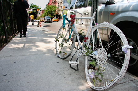 parting: A ghost bike memorial for a killed cyclist at Soho streets