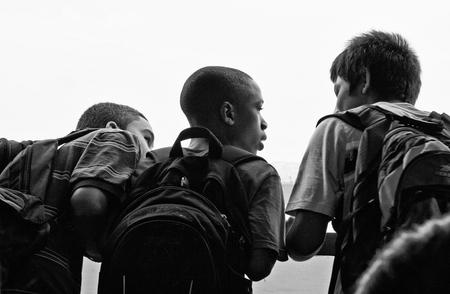 staten: NEW YORK - JUN 23: Young schoolchildren observe the Manhattan Slyline on board of Staten Island Ferry, June 23, 2008 in New York