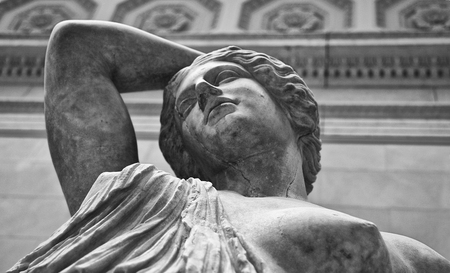 ladies bust: Marble statue of a wounded Amazon. Black and white shot Stock Photo