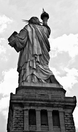 colossal: A shot of this colossal neoclassical sculpture on Liberty Island in New York Harbor, designed by F. Bartholdi and dedicated on October 28, 1886