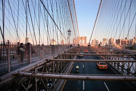 pillage: NEW YORK - JUN 25: Local people, tourists and cars on Brooklyn bridge, June 25, 2008 in New York