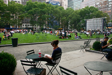 bryant park: NEW YORK - JUNE 26: People enjoying a nice day in Bryant Park on June 26, 2008 in New York City, NY. Bryant Park is a 9,603 acre privately managed park in the center of Manhattan.