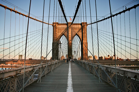 river scape: Local people and tourists walking Brooklyn bridge