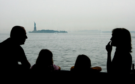 staten: Family observe the Liberty Statue on board of Staten Island Ferry