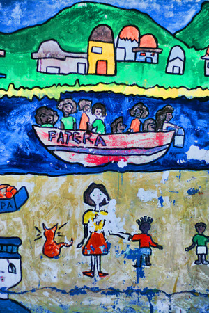 wall paintings: TARIFA, CADIZ, SPAIN - AUGUST 15: Paintings of children about the social problema of pateras. Tarifa, August 15th, 2008. Dinghy that arrives to spanish coast with illegal inmigrants from Africa