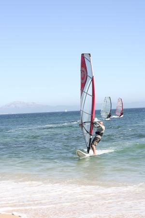 windsurfers: TARIFA, CADIZ, SPAIN - AUGUST 17: Unidentified Windsurfers close Punta Paloma Beach, South of Spain. Tarifa, August 17th, 2008 Editorial