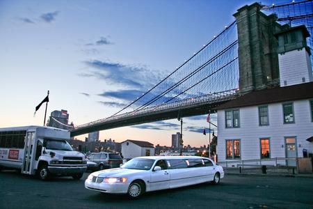 june 25: NEW YORK - JUN 25: A limousine waits beside the Brooklyn Bridge, New York, June 25, 2008 in New York