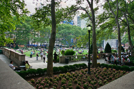 bryant: NEW YORK - JUNE 26: People enjoying a nice day in Bryant Park on June 26, 2008 in New York City, NY. Bryant Park is a 9,603 acre privately managed park in the center of Manhattan.