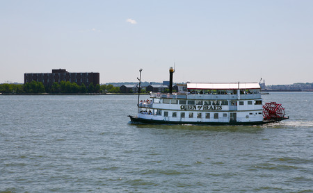 paddle wheel: NEW YORK CITY, USA - JUNE 24 : Paddle Wheel Queen of Hearts steamboat is floating with tourists around Manhattan, June 24, 2008 in New York.
