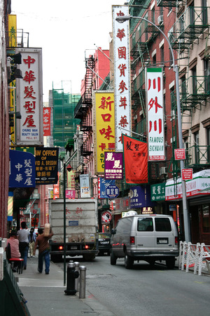 tenement buildings: NEW YORK - JUNE 24: Pell Street in Chinatown in Manhattan. June 24nd, 2008 in NY, USA. Pell Street, the main street where the Chinese community made its start in the old tenement buildings