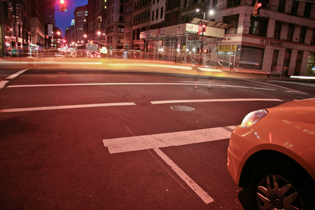 taxicabs: NEW YORK - JUNE 22: New York yellow cabs in motion by a city street scene. On June 22, 2008, NY, USA