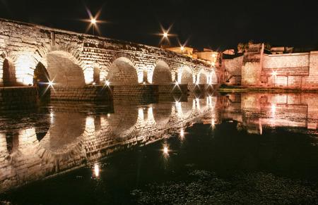 moorish: Roman bridge and alcazaba or moorish fortification at night, Merida, Spain
