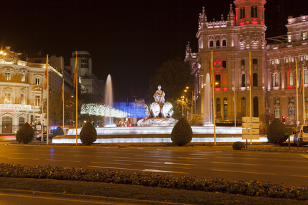 cibeles: MADRID - DECEMBER 5:  Cibeles Fountain and the City Council at night on december 5, 2015 in Madrid, Spain