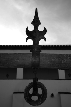 pulley: Old pulley hanging from a wooden beam for water well, Olivenza, Spain Stock Photo