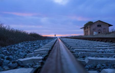 badajoz: Railway tracks with abandoned rural station at dusk, Badajoz, Spain