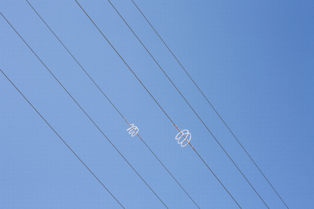 electric material: Power line wires over blue sky. Closeup Stock Photo