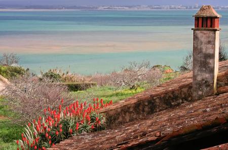 smokestack: Colorful landscape with smokestack at Lagos coastline, Portugal Stock Photo