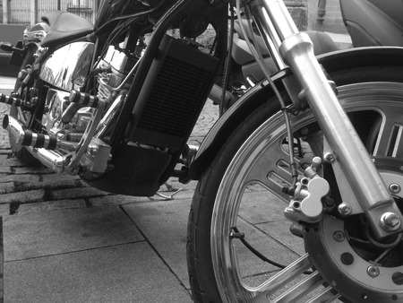 Close up view of a shiny chopper motorcycle engine. Black and white shot