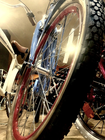 'cycles: Vintage cycles retailer with bikes on display. Low angle