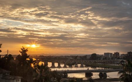 badajoz: Sunset with Badajoz bridges over Guadiana river Stock Photo