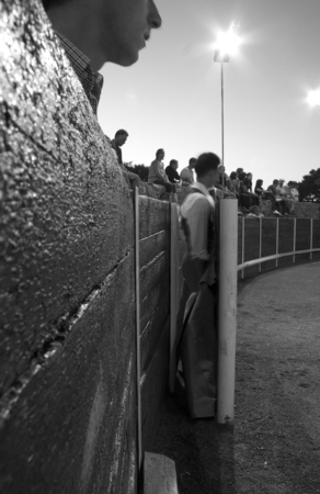 bullfight: OLIVENZA, SPAIN, JULY 31: the toreros wait for performs at night training bullfight for heifers or tentadero. Black and white shot