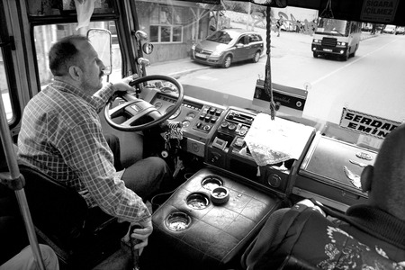 ISTANBUL - SEPT 9: Unidentified man driving urban bus, Istanbul, Turkey on Sept 9, 2009